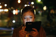 Woman looking smartphone Royalty Free Stock Photos