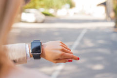 Woman looking at smartwatch Royalty Free Stock Image