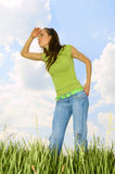 Woman looking for something. On the grassland Stock Image