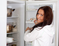 Woman looking for something in the fridge Royalty Free Stock Image