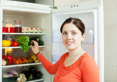 Woman looking for something in fridge Royalty Free Stock Photos