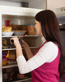 Woman looking for something in fridge Royalty Free Stock Photography
