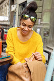 Woman looking for something in her handbag at cafe Royalty Free Stock Image