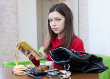 Woman looking for something in her purse Stock Photography
