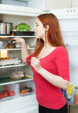 Woman looking for something in refrigerator Stock Photography