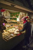 Woman looking something to buy in winter market i Royalty Free Stock Images