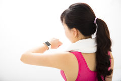 Woman  looking at sports smart watch Royalty Free Stock Images