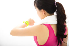 Woman  looking at sports smart watch Stock Photos