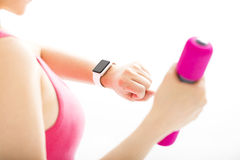 woman  looking at sports smart watch Royalty Free Stock Photos