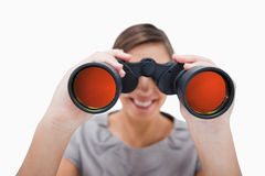 Woman looking through spyglasses Royalty Free Stock Photos