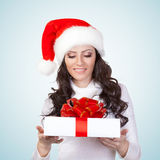 Woman looking st gift box Royalty Free Stock Photography