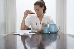 Woman Looking At Stain On Shirt royalty free stock images