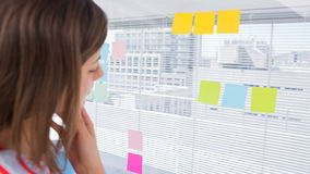 Woman looking at sticky note Stock Photos