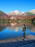 Woman looking at Strbske Pleso, High Tatras Royalty Free Stock Photo
