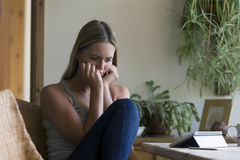 Woman looking stressed with technology Stock Photography