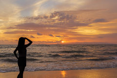 Woman looking in the sunset Royalty Free Stock Photography