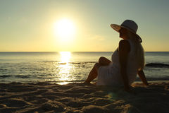 Woman looking into the sunset royalty free stock photo