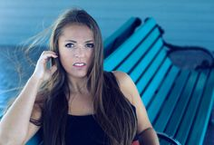 Woman looking surprise portrait outside bench park Royalty Free Stock Image