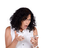 Woman looking surprised to phone. Stock Photography