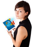Woman looking at tablet with colourful diagrams Stock Photo