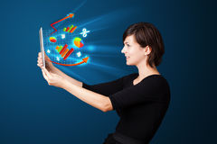 Woman looking at tablet with colourful diagrams Stock Images
