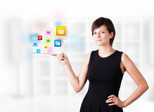 Woman looking at tablet with colourful icons Stock Photo
