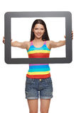 Woman looking through tablet frame Stock Images
