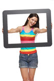 Woman looking through tablet frame Royalty Free Stock Photo