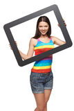 Woman looking through tablet frame Stock Photos