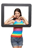 Woman looking through tablet frame Royalty Free Stock Image