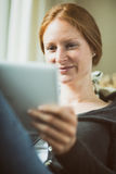 Woman Looking at a Tablet Royalty Free Stock Photography