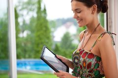 Woman looking at tablet pc Stock Photo