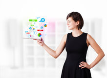 Woman looking at tablet with technology icons Royalty Free Stock Images