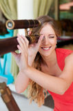Woman looking through the telescope Royalty Free Stock Photography