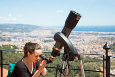 Woman looking in telescope Stock Image