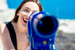 Woman looking with telescope Royalty Free Stock Photo