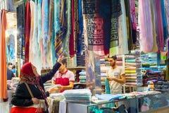 Woman looking textiles, Grand Bazaar stock image