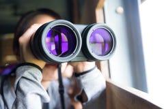 Woman looking though binocular Royalty Free Stock Photo