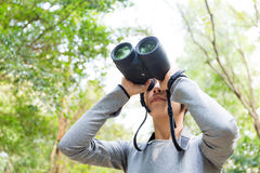 Woman looking though binocular Royalty Free Stock Images