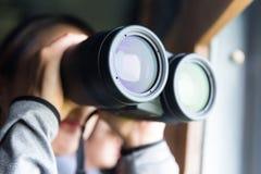 Woman looking though binocular Royalty Free Stock Photography