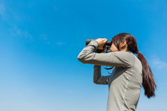 Woman looking though binoculars Royalty Free Stock Photos