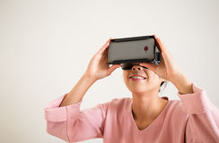 Woman looking though vr device Royalty Free Stock Photography