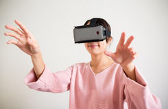 Woman looking though vr device and hand want to touch some Stock Photography