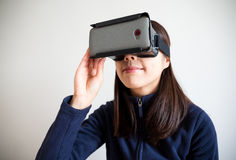 Woman looking though vr Stock Photo