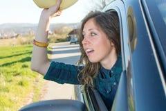 Woman looking thru car window stock image