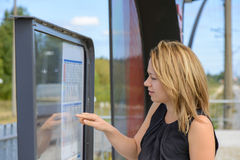 Woman looking a timetable in a station Royalty Free Stock Photo