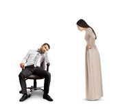 Woman looking at tired man Royalty Free Stock Photo