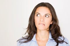 Woman looking to her left with a grimace Royalty Free Stock Images