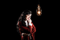 Woman looking to the light bulb Royalty Free Stock Photography