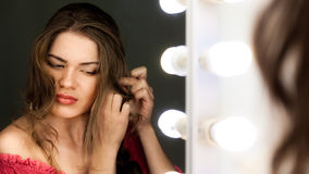 Woman looking to the mirror Stock Image